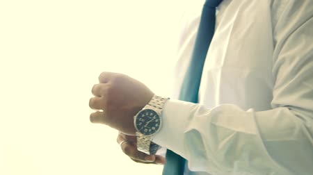Black man wearing a watch