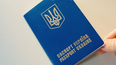 Close up of Ukrainian passport, Ukrainian passport check