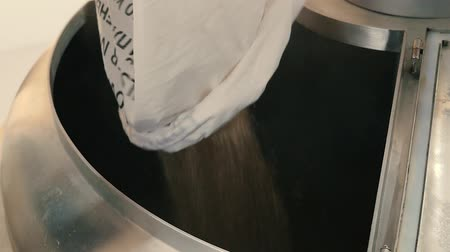 Brewer pours malt into the cooking tank