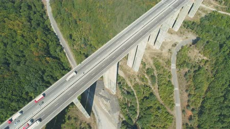 strukturální : Aerial drone view of highway bridge with lot of traffic. Trucks Passing trough highway bridge