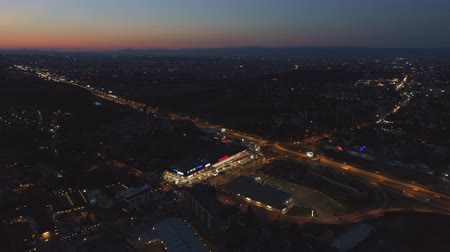 otoyol : Aerial Drone view of nightlife in Sofia, Bulgaria. Traffic lights during the night with scenic sky