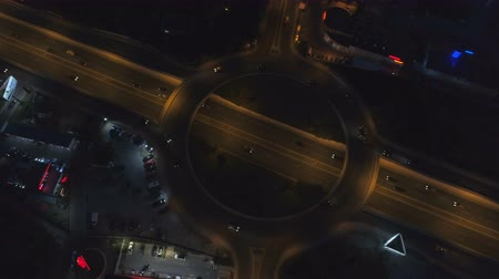 hurry up : Roundabout road with car lights in city at night. Drone top view of Sofia, Bulgaria Stock Footage