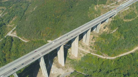 strukturální : Aerial drone view of highway bridge with many cars passing during summer day