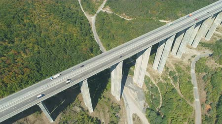 двойной : Bebresh Viaduct with daily traffic in summer day in Bulgaria