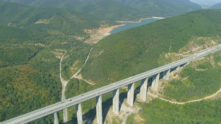 oszlopsor : Drone view of blue lake and Bebresh Viaduct motorway in Bulgaria