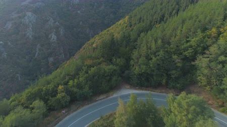poros : An Aerial View Of A Mountain Pass Asphalt Road with Beautiful Forest Landscpae