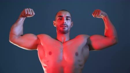 weightlifting : Male Fitness model showing muscular arms, chest and shoulders, posing for photo session