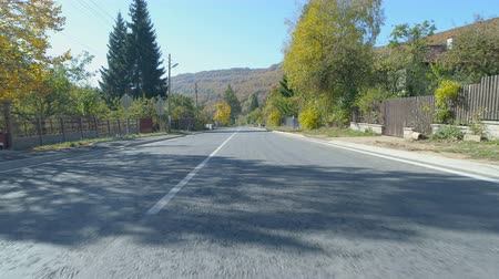 búlgaro : On the road, view from drone. Peaceful asphalt road in Bulgarian village in the autumn