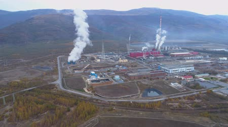 dioxid : Pollution smoke coming out from smokestack of copper smelter refinery
