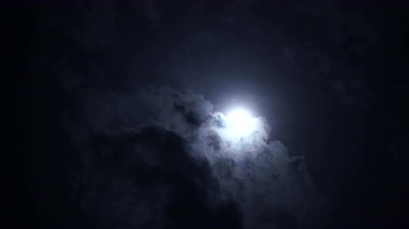 fáze : Full moon at night with bright and dark clouds. Spooky, horror concept