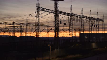visão global : High voltage electric towers during sunset, environmental damage concept