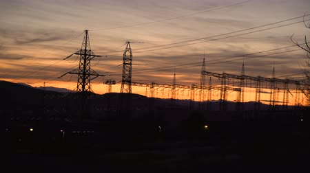 visão global : High voltage electric pole and Power lines during sunset