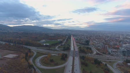 államközi : Aerial view of rush hour in Boyana, Sofia. Urban view with scenic colorful sky Stock mozgókép