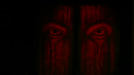 szatan : multi color lighting on devil face door feel macabre mystery, full HD. Wideo