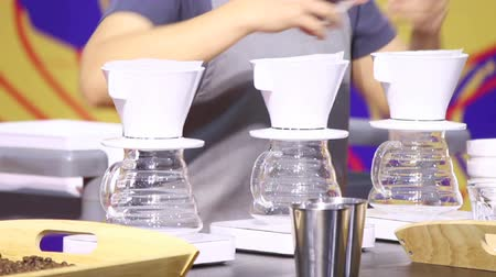 clipe de papel : Footage showcase Drip coffee maker and Barista add ground coffee with filter on cup.