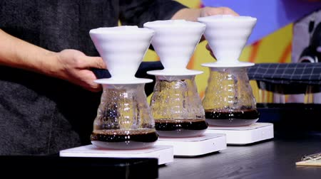 part of clip : Footage showcase Drip coffee maker and Barista wait coffee drip to cup.