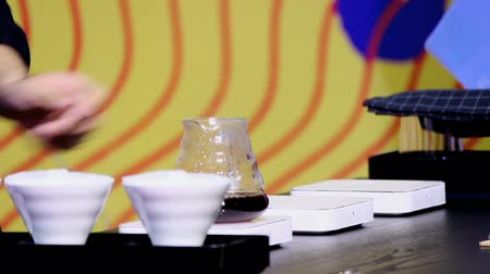 coffee grounds : Footage showcase Drip coffee maker and Barista wait coffee drip to cup.