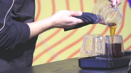 vdo : Footage showcase Drip coffee maker and Barista add ready Drip coffee to drink in cup.