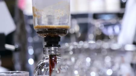 vdo : Footage syphon Coffee or Vacuum Coffee is full immersion tasteful and Barista boiling roasted coffee in hot water by Beam heater.