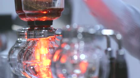titular : Footage syphon Coffee or Vacuum Coffee is full immersion tasteful and Barista mix coffee and hot water in vacuum glass chambers by Beam heater.