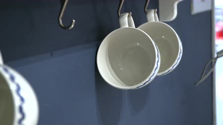 Hanging coffee mugs on the wall. Stock Footage