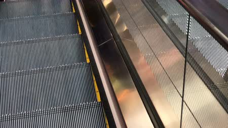 Moving escalator in shopping mall.