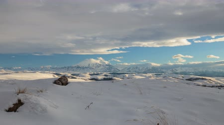 Russia, time lapse. Winter views of the snowy mountains of the Caucasus. Formation and movement of clouds over mountains peaks. Stock Footage