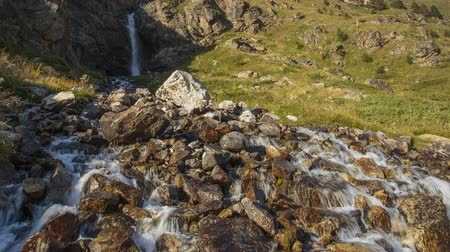 nuvem : Russia, time lapse. Movement of clouds and water flows in a stormy river in the Caucasus mountains in summer Stock Footage