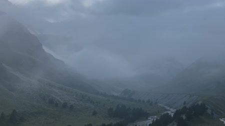 Russia, time lapse. Movement of clouds and water flows in a stormy river in the Caucasus mountains in summer Stock Footage