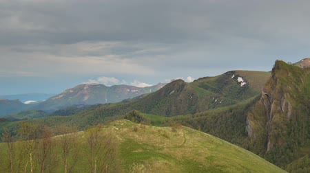 Russia, time lapse. The formation and movement of clouds over the summer slopes of Adygea Bolshoy Thach and the Caucasus Mountains