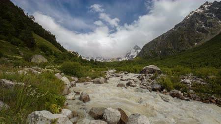 great video : Movement of clouds and water flows in a stormy river in the Caucasus mountains in summer