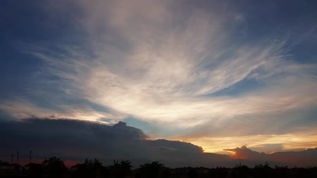 evening sun : Time lapse shot of cloudy sky in the evening Stock Footage