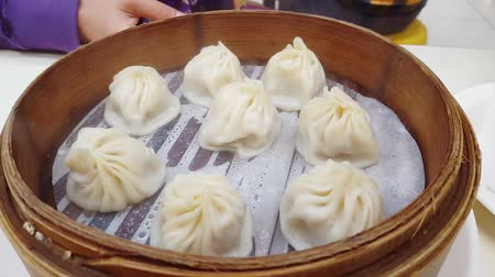 bamboo steamer : Xiao Long Bao is  steamed dumpling of Chinese Traditional Cuisine