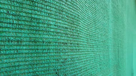 mesh : Closeup green shading net moving Stock Footage