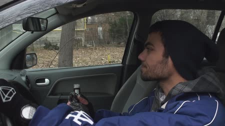 stoned : Young Drunk Man Getting Into His Car To Do Some Drunk Driving Front-Shot