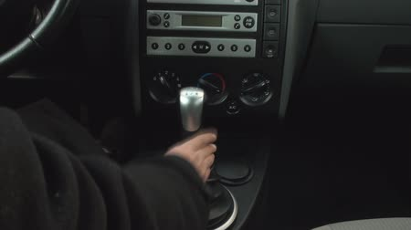 výbava : Adult Woman Shifts Gears In Car