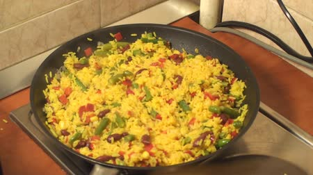 meksika : Mexican Rice Cooking In The Frying Pan And Adding Salt