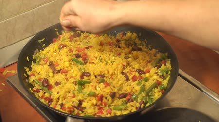 peper : Mexican Rice Cooking In The Frying Pan And Adding Some Ingredients Stock Footage