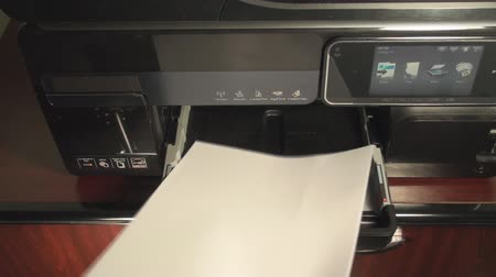 сканер : Man Inserting White Sheets Of Paper Into An Office Printer Point Of View