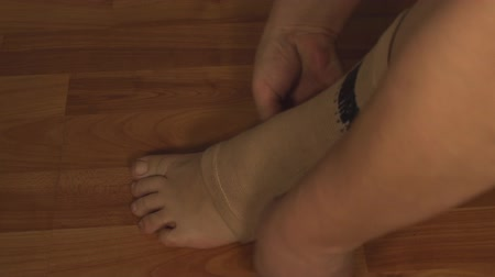 kostka : Man Putting Ankle Guard, Ankle Pain, Injury, Accident Side-Shot