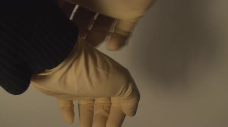 luva : Man Putting Latex Gloves, Hospital, Hygiene, Protection, Side-Shot