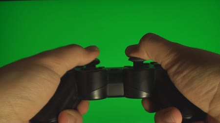 chroma key background : Hands Playing On A Video Console Controller On A Green Screen, Chroma, Key Stock Footage