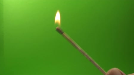 chroma key background : Hand Igniting A Long Match On A Green Screen, Chroma, Key, Fire Stock Footage