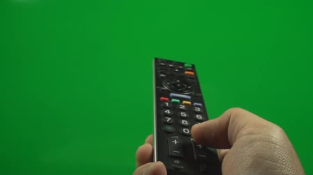 tenso : Television Remote On A Green Screen Pushing The Switch Channel Button, Chroma