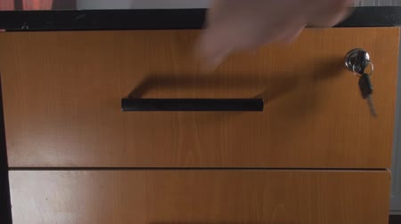 бухгалтер : Opening A Small Cabinet And Putting Documents In, Office, Business, Front Shot Стоковые видеозаписи