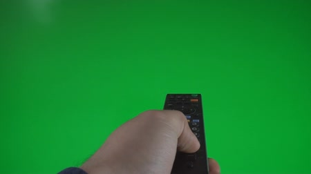 tenso : Man Surfing Channels On A Green Screen, Chroma, Key, Gesture, Point Of View