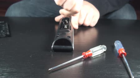toolbox : Young Male Unscrewed Some Bolts Out Of His Remote Control Front-Shot Stock Footage