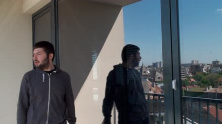cygaro : Young Man Lighting Up A Cigarette, Office, City, Reflection, Skyline Wideo