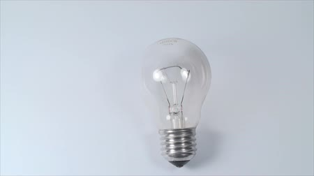 bulbo : Light Bulb On A White Background, Power, Light, Eco, Friendly, Tilt Vídeos