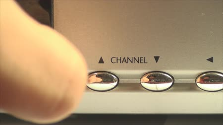 comutar : HDTV Box Hand Detail Pushing The Channel Button, Television, High Definition, On Stock Footage